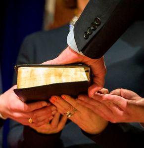 Hand on Bible