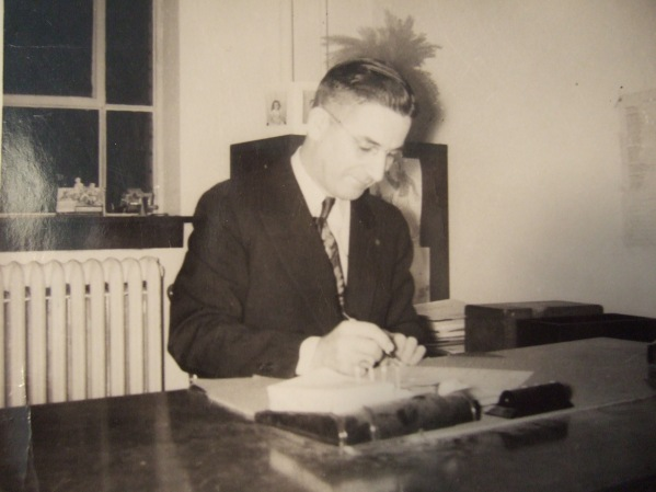 5. Marion Howard at his desk, Longfellow School